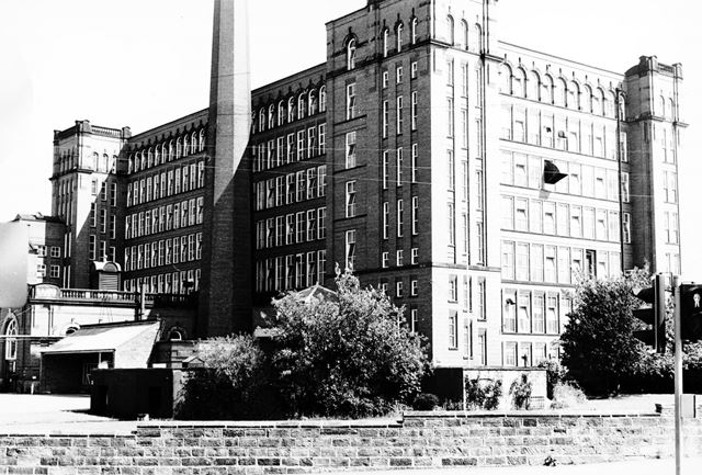 View of Strutt's East Mills from the Triangle at the Bridgefoot - Matlock Road (A6) junction