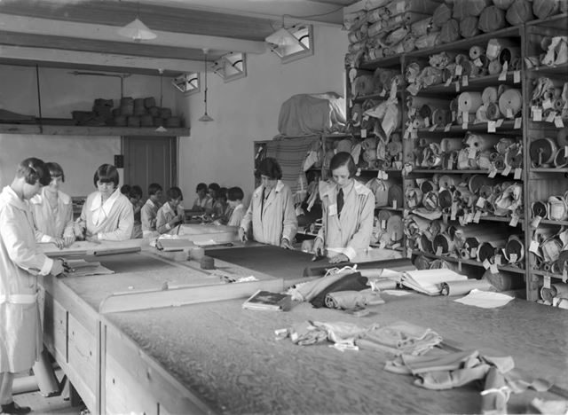 Cloth cutting at Baker and Sons, clothing factory