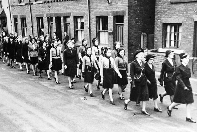 Staveley Girl Guides marching along Chesterfield Road, Staveley