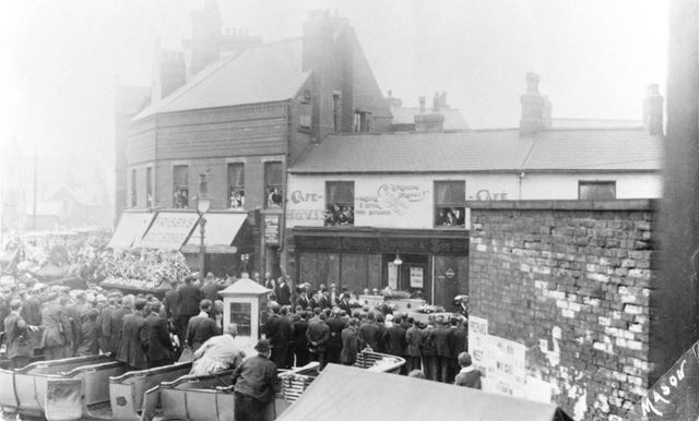 Charles Markham's Funeral passing Frisby's Boot Store and Connie Brook's Cafe and Butchers