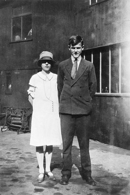 Cecil G Adams and girl, outside Boldry's Shop, Lowgates
