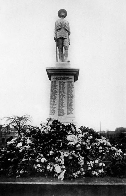 Staveley War memorial (after a memorial service, showing flowers and wreathes)