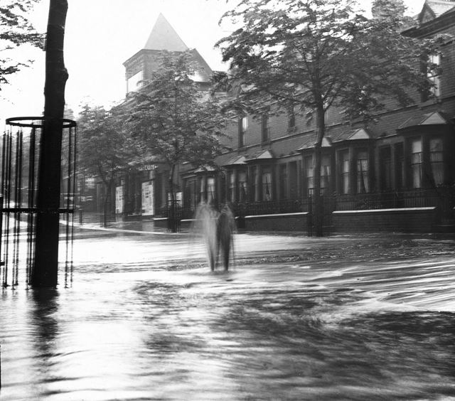 The Coliseum Theatre and Lord Haddon Road in flood from a burst water pipe