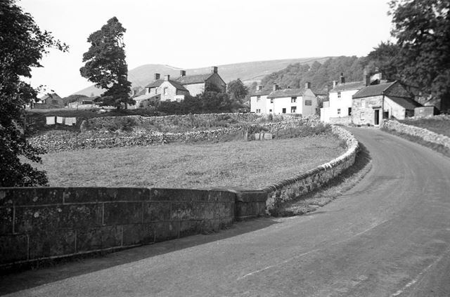 The village of Crowdecote with the Packhorse inn on the right of the picture