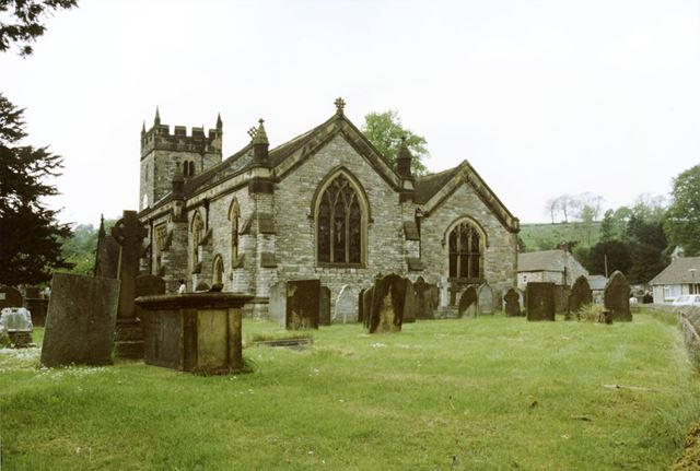 Church and graves of the Holy Trinity Parish Church of Ashford in the Water.