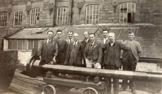 Workers outside the mill