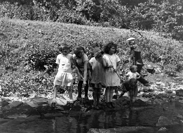 Children fishing in the River Manifold at Ilam. 1929