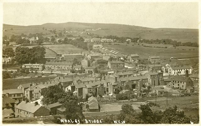 General view of Whaley Bridge, with railway line in foreground, early 20th century