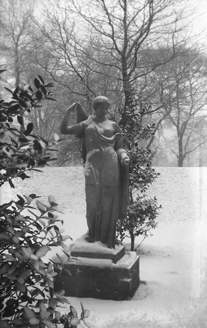 Classical statue in the snow at The Arboretum, Rose Hill, Derby, c 1914 ?
