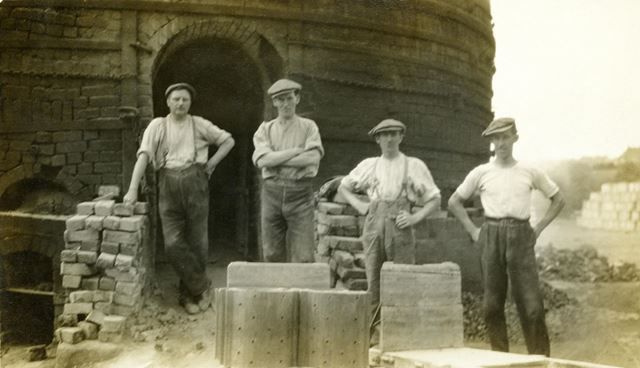 A kiln gang by a round down-draught kiln at the brick and sanitary pipe works of W H and J Slater, D
