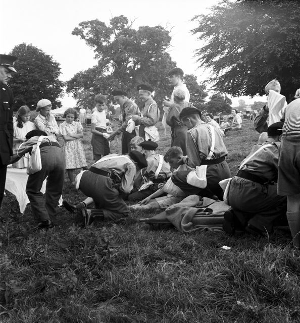 A group of Boy's Brigade or St John's Ambulance members demonstrating first aid at a Stanton Works A