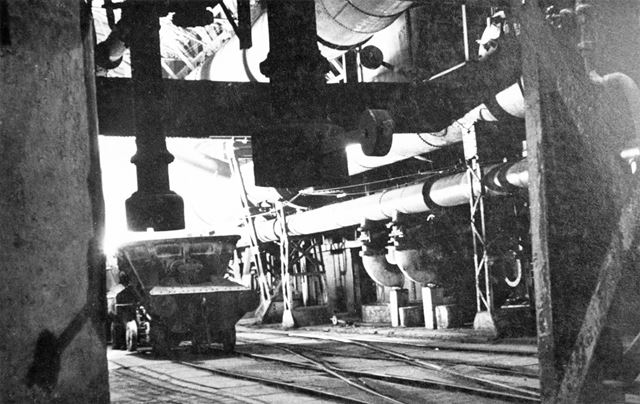 Molten-iron or hot slag ladles/wagons being filled from the tapped blast-furnaces