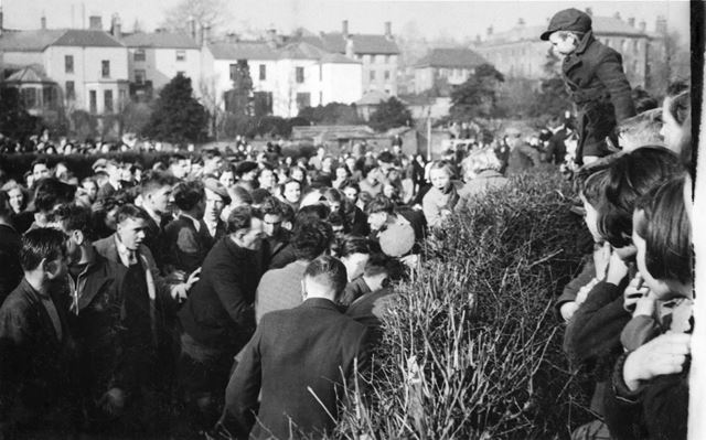 Shrovetide Football Game: The Hug, with players pushing from both sides and the ball in the middle