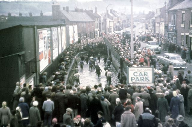 Shrovetide Football Game: the ball has gone in the Henmore (culverted now, site of supermarket)