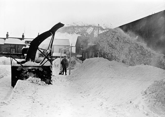 Clearing snow off the pitch, Buxton Football Club, Silverlands, Buxton, 1963