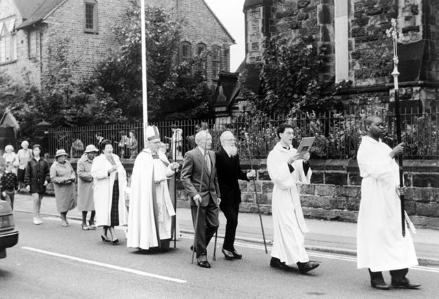View of a procession leaving St James churchyard